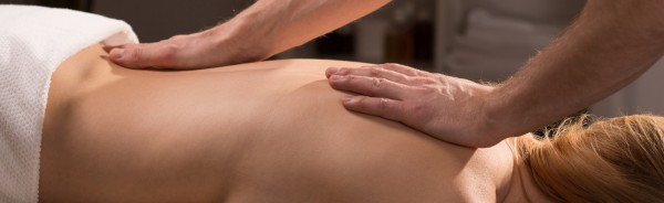 Close-up of male hands doing back massage